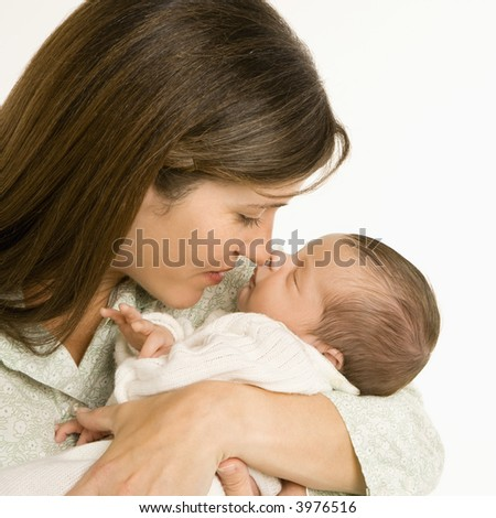 Mother nuzzling sleeping baby with nose and smiling. - stock photo