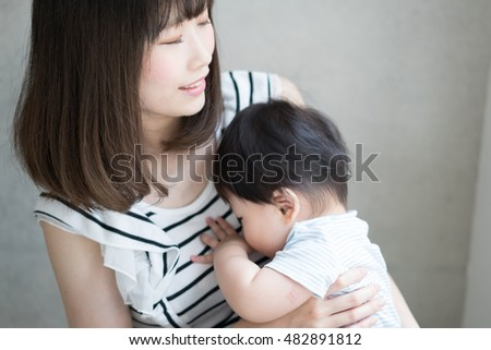 mother pacifying crying baby