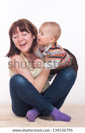 Mother playing whit the son - stock photo