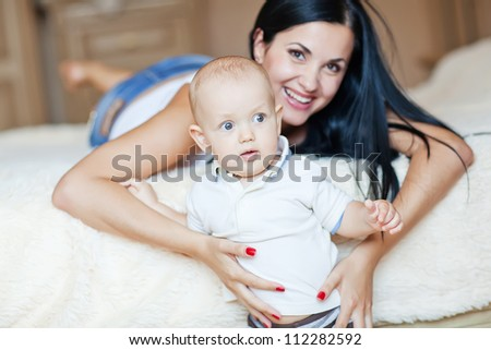 mother playing with baby - stock photo