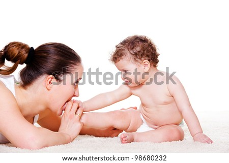 Mother playing with baby foot