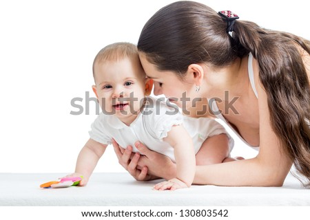mother playing with baby girl isolated on white - stock photo