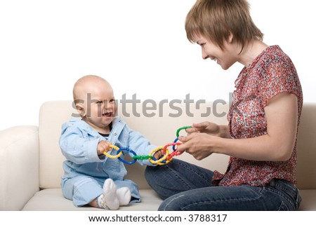 Mother playing with baby, hand blured in motion