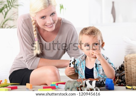 Mother playing with her son. - stock photo