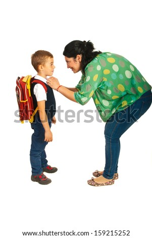 Mother prepare boy for school isolated on white background - stock photo