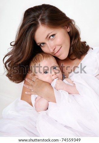 Mother presses the small son to a breast - stock photo
