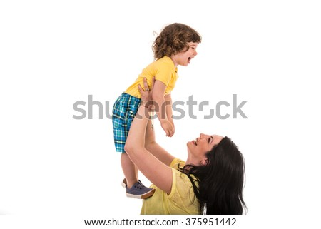 Mother raising her laughing toddler son and having fun together isolated on white background