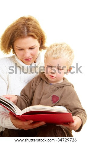 Mother reading a book with her son - stock photo