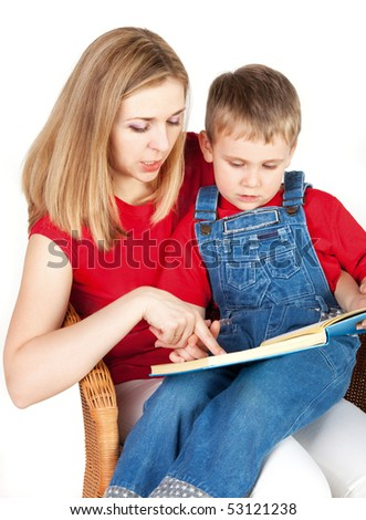 Mother reading book her son - stock photo
