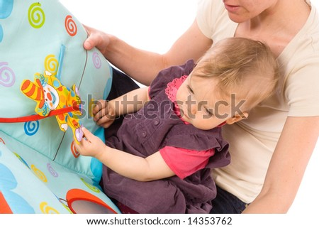 Mother reading for baby girl (9 months) from story book. - stock photo
