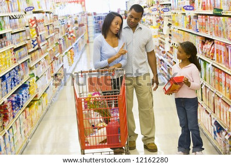 Mother refusing to buy product for child in supermarket - stock photo