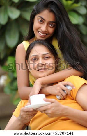 Mother relaxing with daughter - stock photo