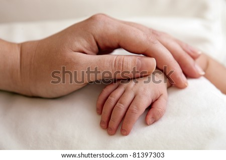 Mother's and newborn's hands
