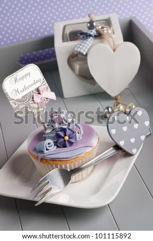 Mother's day cupcake in on a dinner tray - stock photo