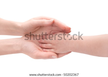Mother's hands hold child's hand - stock photo
