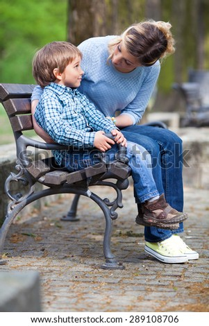 Mother scolding her little son in a park - stock photo