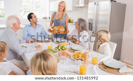 Mother serving the turkey for thanksgiving - stock photo