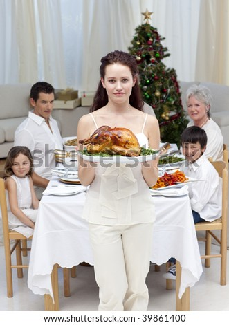Mother showing turkey for Christmas dinner at home - stock photo