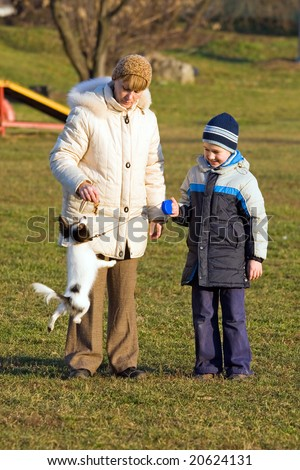 Mother, son and puppy of breed papillon - stock photo