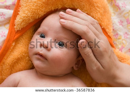 mother stroke her son with hand - stock photo