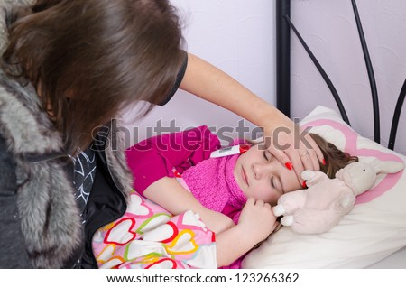 Mother taking care about sick sleeping daughter - stock photo