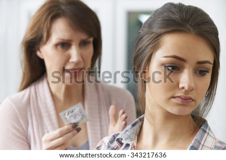 Mother Talking To Teenage Daughter About Contraception - stock photo