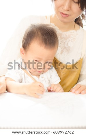 Mother teaching babies to study
