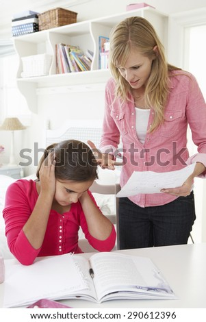 Mother Telling Daughter Off For Bad School Report - stock photo