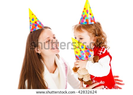 Mother, toddler and toy in party hats