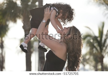 Mother tossing her child in the air