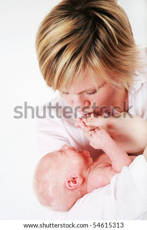 Mother trying to rest her baby - stock photo
