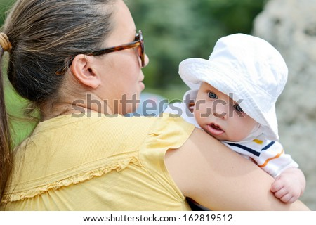 mother walking with baby boy - stock photo