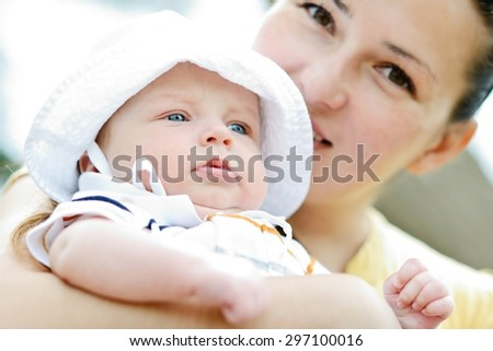 mother walking with sweet little baby boy  - stock photo