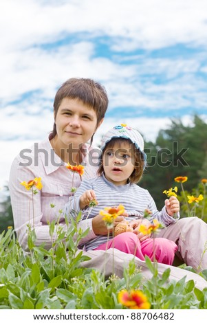 Mother with a daughter on the nature