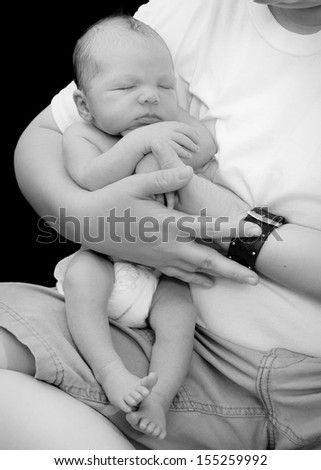 Mother with a newborn baby on her lap - stock photo