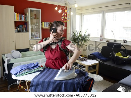 mother with baby and smartphone