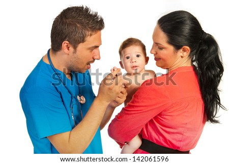 Mother with baby at doctor isolated on white background - stock photo