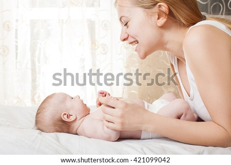 Mother with baby at home. Newborn - stock photo
