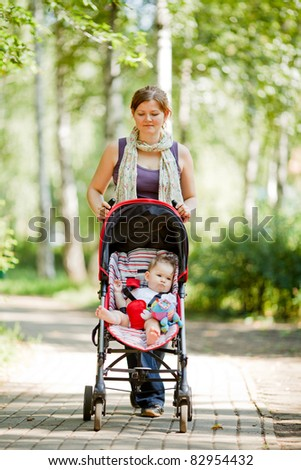 Mother with baby at outdoor - stock photo