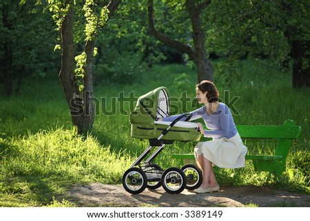 Mother with baby carriage - stock photo