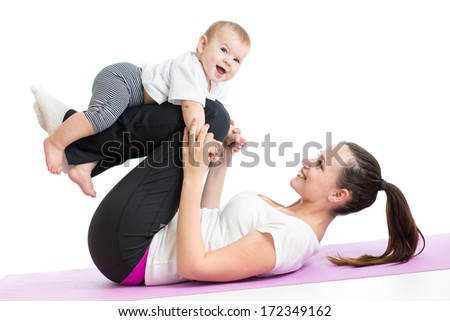 mother with baby doing gymnastics and fitness exercises - stock photo