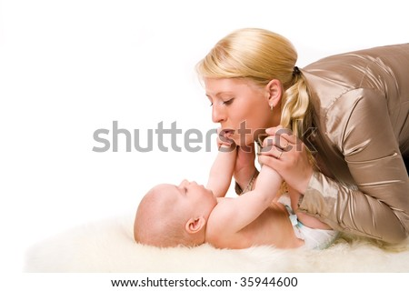Mother with baby happy together isolated on white