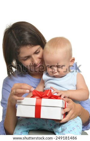 Mother with baby opening present - stock photo