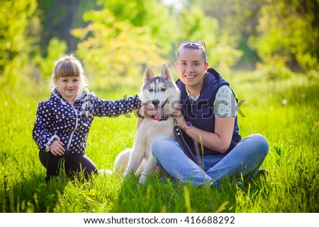 Mother with baby outdoor with dog husky park - stock photo