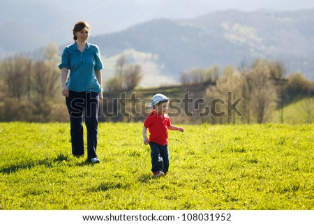 Mother with baby - Walk in the mountains at sunset - stock photo