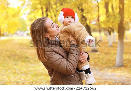 Mother with baby walks in autumn park