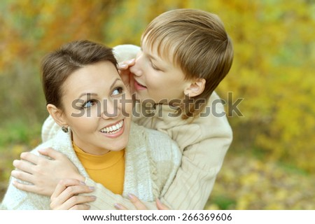 Mother with boy on walk in autumn park