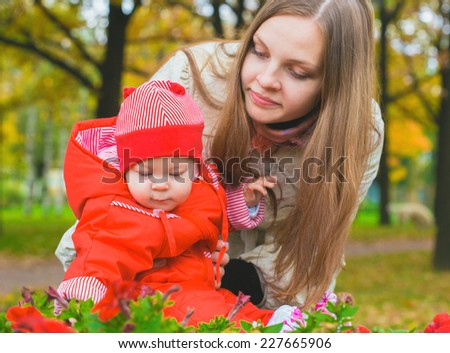 mother with child infant in the park in autumn