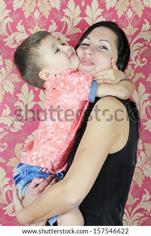 mother with child near beautiful new year's fir tree