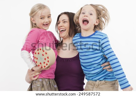 Mother with children celebrating mother day and valentine day - stock photo